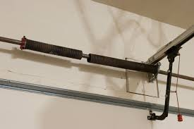 Garage door spring repair denver co same day service for Garage door torsion springs denver