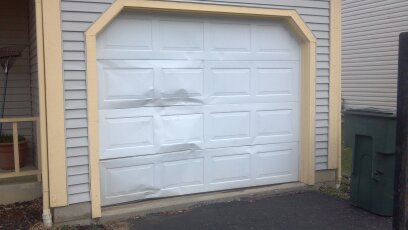 Expert Repair And Installation Of Damaged Garage Door Panels In Denver